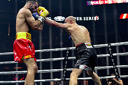 October 21, 2017 - Newark, New Jersey, USA - MURAT GASSIEV (XXX trunks) and KRZYSZTOF WLODARCZYK battle in a cruiserweight bout at the Prudential Center in Newark, New Jersey. (Credit Image: © Joel Plummer via ZUMA Wire)
