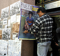 """19/04/04 - DIEGO MARADONA WAS INTERNED AT HOSPITAL - Buenos Aires - Argentina. <br />The ex Argentinean football player was interned at hospital yestarday night.<br />Here MARADONA'S FANS outside the clinic.<br />Pancart """" FORZA DIEGO """" BE STRONG DIEGO""""<br />©A.K./Argenpress.com"""
