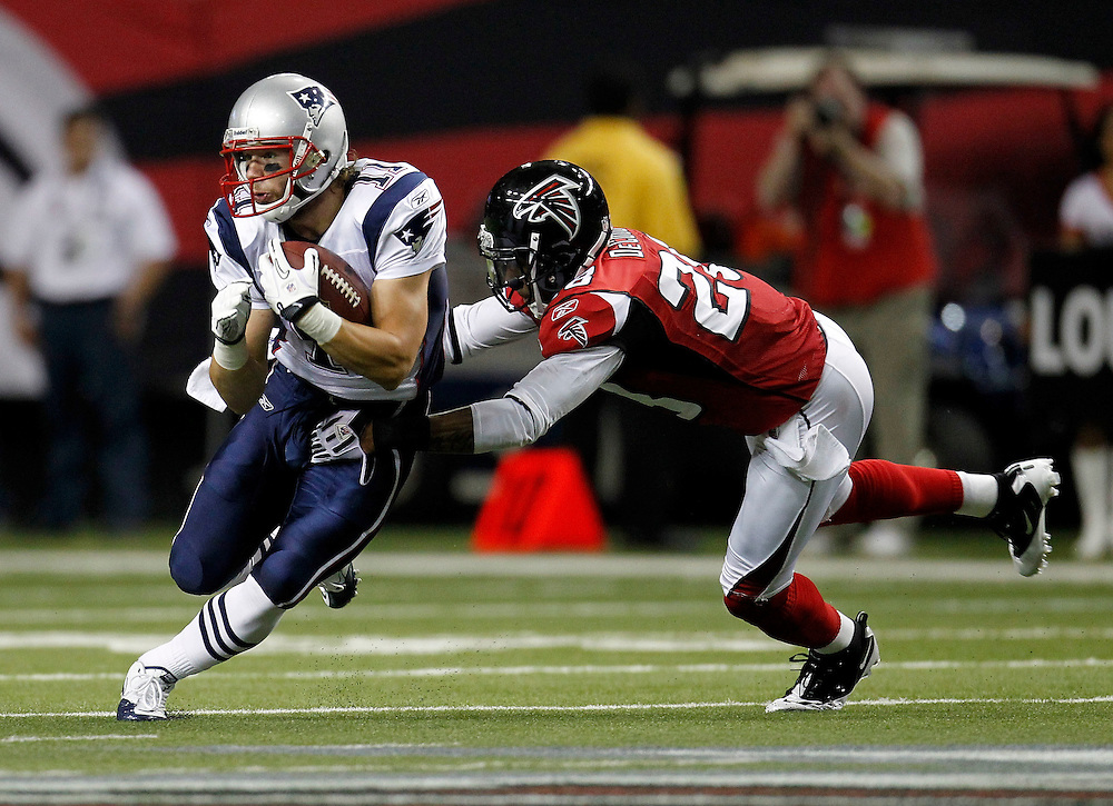 ATLANTA - AUGUST 19:  Safety Thomas DeCoud #28 of the Atlanta Falcons chases wide receiver Julian Edelman #11 of the New England Patriots after Edelman's reception during the preseason game at the Georgia Dome on August 19, 2010 in Atlanta, Georgia.  (Photo by Mike Zarrilli/Getty Images)