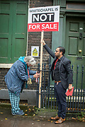 Councillor Ehtasham Haque and Jill Wilson during a campaign against London Borough of Tower Hamlets planning decision to develop the Whitechapel Bell Foundry into a boutique hotel on the 9th November 2019 in East London in the United Kingdom. Whitechapel Bell Foundry closed in June 2017, having cast bells in the East End for almost 450 years. Campaigning with East End Preservation Society, directly petitioning Tower Hamlets Council to preserve the foundry on the grounds of its great historical importance. Operating in Whitechapel from the 1570s — and from its current location since the mid 1740s — the foundry produced world famous bells, including Big Ben, 1858, and the Liberty Bell. Before it shut its doors, Whitechapel was one of two remaining bell foundries in the UK. The site is now owned by property developer, Raycliff, which wants to turn the site into a boutique Hotel.