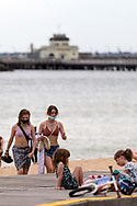 Young beach goers are seen at St Kilda Beach during COVID-19 in Melbourne, Australia. Premier Daniel Andrews comes down hard on Victorians breaching COVID 19 restrictions, threatening to close beaches if locals continue to flout the rules. This comes as Victoria sees single digit new cases. (Photo by Dave Hewison/Speed Media)