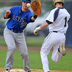 Hammonton first baseman Branon Kincaid is dragged off the bag by a wide throw, letting Freehold Boro's Matt Holtz reach first base safely during NJSIAA Group III baseball semifinal action between Hammonton High School and Freehold Boro High School at Monmouth University..Photo/Will Schneekloth special to The Daily Journal