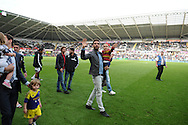 Chico Flores (c) waves to loyal Swansea City fans at full time as the player did a walk around the pitch for fans.<br /> Barclays Premier league match, Swansea city v Southampton at the Liberty stadium in Swansea, South Wales on Saturday 3rd May 2014.<br /> pic by Phil Rees, Andrew Orchard sports photography.