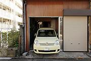 small car in a small garage Japan Yokosuka