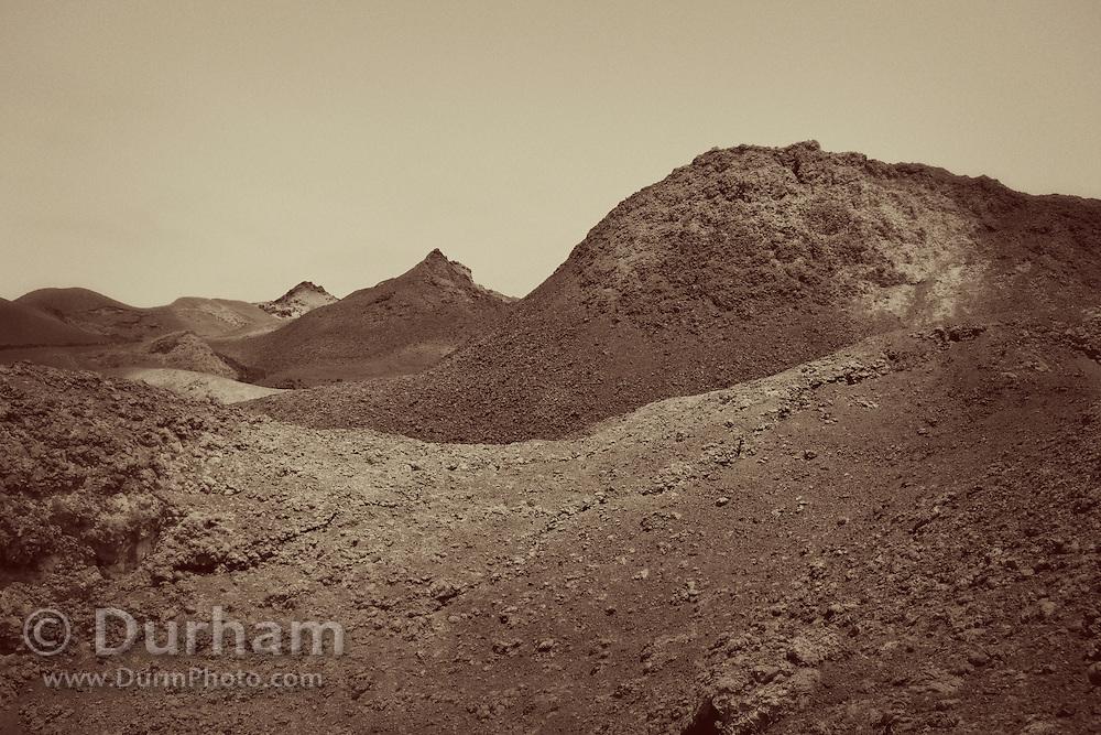 A harsh volcanic landscape inside the crater of Sierra Negra on Isabela Island, Galapagos Archipelago - Ecuador.
