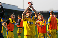 Wimbledon defender Will Nightingale (5) applauds the fans at full time during the EFL Sky Bet League 1 match between Scunthorpe United and AFC Wimbledon at Glanford Park, Scunthorpe, England on 30 March 2019.