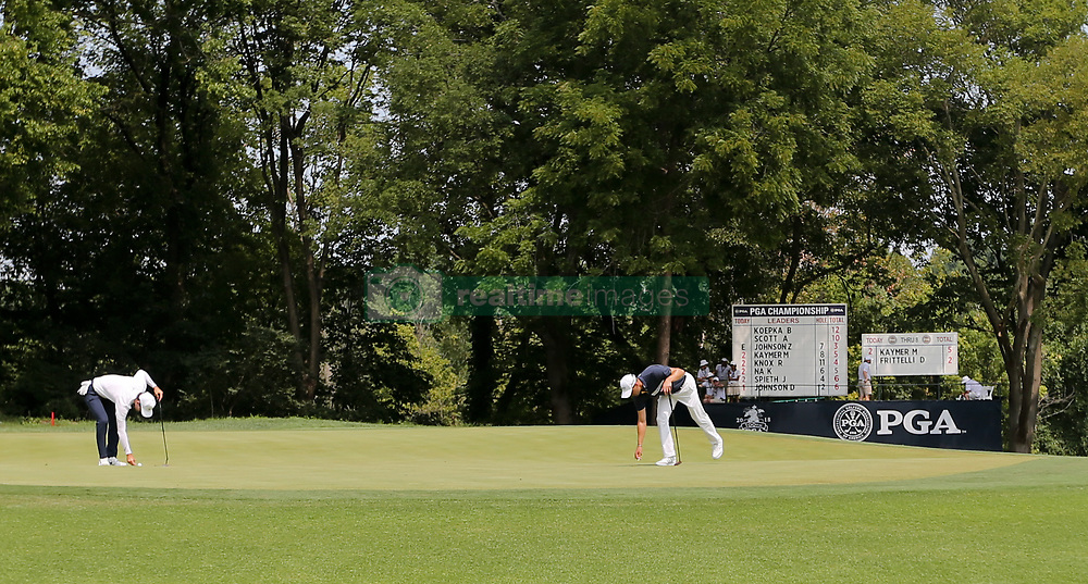 August 12, 2018 - St. Louis, Missouri, United States - Martin Kaymer (R) lines up a putt on the 9th green during the final round of the 100th PGA Championship at Bellerive Country Club. (Credit Image: © Debby Wong via ZUMA Wire)