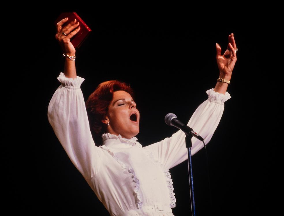 Anita Bryant holds New Testament Bible as she sings before a Christian gathering in Atlanta Georgia.