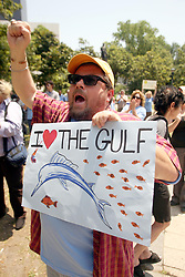 08 May 2010. New Orleans, Louisiana, USA. <br /> Buddha Bill McPherson joins protesters listening to Allison Chin, President of the Sierra Club at a rally to demonstrate against British Petroleum's massive devastating oil leak in the Gulf of Mexico.<br /> Photo;Charlie Varley/varleypix.com