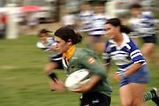 Girl from champion Agraria de Coimbra team escapes from pursuiting girl from Tecnico team to score another try-out for her side.