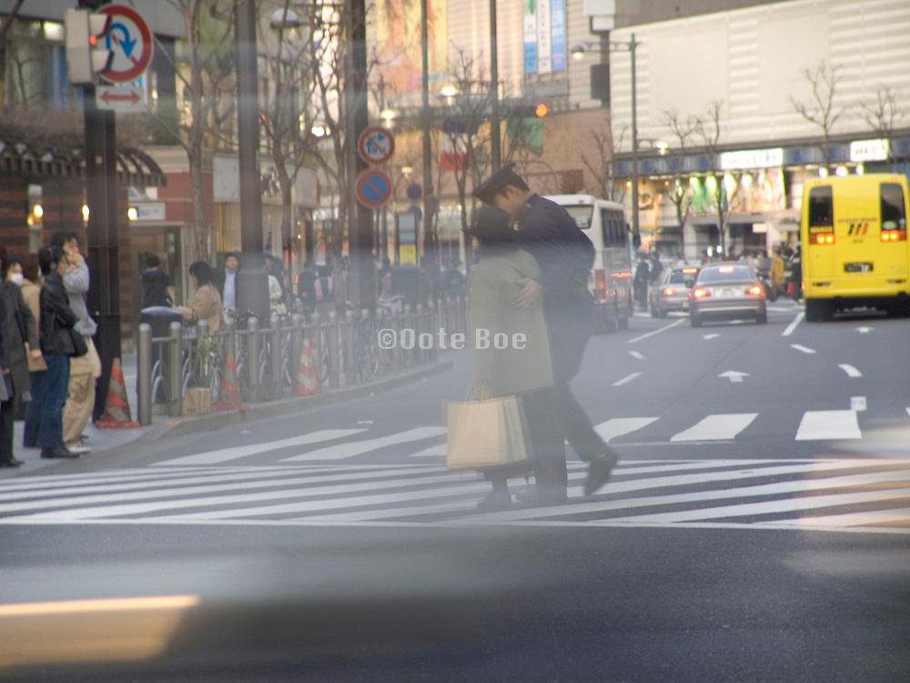 elderly woman helped by police to cross the road Shibuya Tokyo Japan