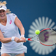 August 21, 2014, New Haven, CT:<br /> Alison Riske hits a backhand during a match against Magdalena Rybarikova on day seven of the 2014 Connecticut Open at the Yale University Tennis Center in New Haven, Connecticut Thursday, August 21, 2014.<br /> (Photo by Billie Weiss/Connecticut Open)