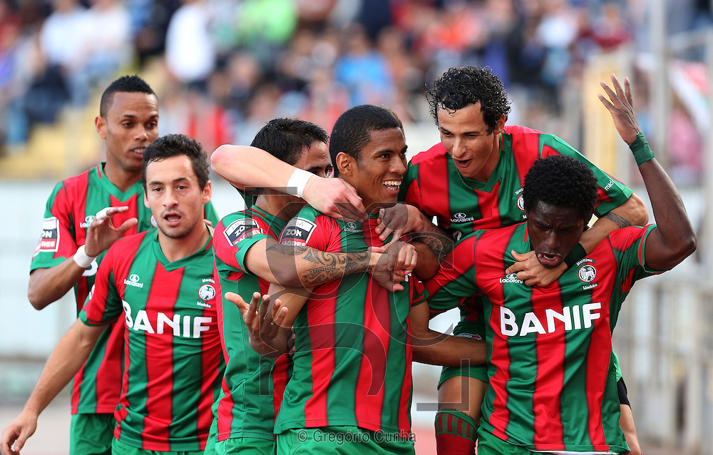 Portugal, FUNCHAL : Maritimo's Brazilian forward Derley (C )  celebrates with his teammates after scoring during the Portuguese League football match  Maritimo vs F.C. Porto at Barreiros Stadium in Funchal on February  01, 2014. AFP PHOTO/ GREGORIO CUNHA