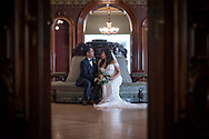 A bride and groom share a quiet moment in the ballroom at the Crocker Art Museum in Sacramento, CA. Wedding photography by Kristina Cilia Photography