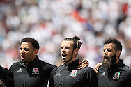 Wales players Hal Robson-Kanu (l) Gareth Bale © and Joe Ledley ® sing the Welsh national anthem ahead of the game. UEFA Euro 2016, group B , England v Wales at Stade Bollaert -Delelis  in Lens, France on Thursday 16th June 2016, pic by  Andrew Orchard, Andrew Orchard sports photography.