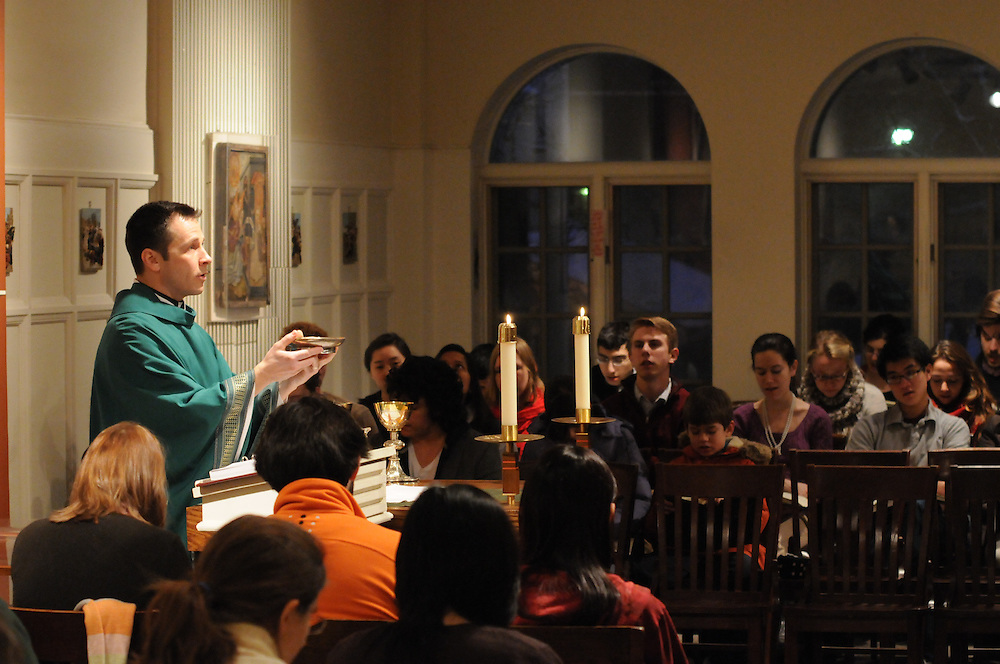 Fr. Brian Welter leads mass at Calvert House at University of Chicago. With Sunday services at 11am, 5pm, and 9pm, Calvert offers the only Catholic masses on the Hyde Park campus. The late mass accommodates student's academic and sports commitments.