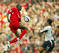 Photo: Aidan Ellis.<br /> Liverpool v West Ham Utd. The Barclays Premiership.<br /> 29/10/2005.<br /> Liverpool's Momo Sissoko jumps to beat West Ham's Hayden Mullins to the ball