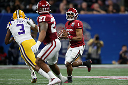 Jalen Hurts #1 of the Oklahoma Sooners rolls out on a  pass play during the first half against the LSU Tigers in the 2019 College Football Playoff Semifinal at the Chick-fil-A Peach Bowl on Saturday, Dec. 28, in Atlanta. (Jason Parkhurst via Abell Images for the Chick-fil-A Peach Bowl)