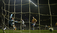 Photo: Andrew Unwin.<br />Newcastle United v Mansfield Town. The FA Cup.<br />07/01/2006.<br />Newcastle's Alan Shearer (obscured) fires home his 200th club goal.