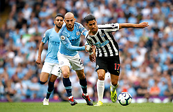 Manchester City's David Silva (left) and Newcastle United's Ayoze Perez (right) during the Premier League match at the Etihad Stadium, Manchester.