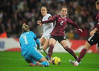 Football - 2019 / 2020 Women's International Friendly - England vs. Germany<br /> <br /> Lucy Bronze of England is foiled by Sophia Kleinherne (2) and goalkeeper, MerleFrohms, at Wembley Stadium.<br /> <br /> COLORSPORT/ANDREW COWIE