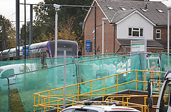 © Licensed to London News Pictures. 10/11/2016. Croydon, UK. Police are seen through netting at Sandilands tram station as investigations are continuing into a tram crash that police say claimed seven lives and injured 50. The driver has been arrested and is being questioned by police. Photo credit: Peter Macdiarmid/LNP