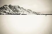 Backcountry skier crossing frozen Jenny Lake, Grand Teton National Park, Wyoming