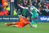 Plymouth Argyle defender Yann Songo'o (4) tackles Luton Town forward James Collins (19) during the EFL Sky Bet League 1 match between Luton Town and Plymouth Argyle at Kenilworth Road, Luton, England on 17 November 2018.