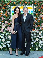 George Clooney and his wife Amal, representing the Clooney Foundation for Justice, arrive to collect an award for their charity work at the People's Postcode Lottery Charity Gala in Edinburgh <br /> <br /> Pictured: George Clooney <br /> <br /> (c) Aimee Todd | Edinburgh Elite media