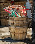 Crab trap floats stacked in bushel basket