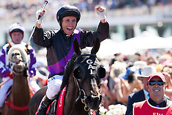 © Licensed to London News Pictures. 5/11/2013. Jockey Damian Oliver riding Fiorente celebrates after winning the race during Melbourne Cup Day at Flemington Racecourse on November 5, 2013 in Melbourne, Australia. Photo credit : Asanka Brendon Ratnayake/LNP
