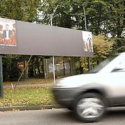 NLD/Huizen/20061025 - Nieuwe verkiezingsborden Naarderstraat Huizen