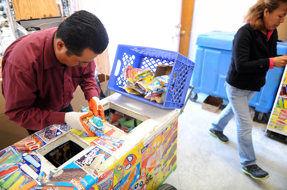 In a morning ritual throughout the warmer months in Salinas, Sabino Martinez, left, and Lydia Quintana stock the ice cream pushcarts of vendors working from Paleteria La Mexicana at 734 East Market St. From this tiny hub full of low white freezers, up to a dozen vendors ringing their rack of bells might cover half the city on foot or by bike in a day's work, making very little money but overjoying children and an occasional adult.