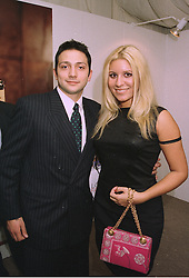 MR ALEX AVEDISSIAN and MISS BEVERLEY BLOOM the millionairess, at a party in London on 26th September 1997.MBR 17