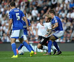 Ipswich Town's Christophe Berra challenges Derby County's Johnny Russell - Photo mandatory by-line: Dougie Allward/JMP - Mobile: 07966 386802 30/08/2014 - SPORT - FOOTBALL - Derby - iPro Stadium - Derby County v Ipswich Town - Sky Bet Championship