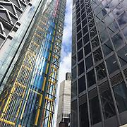 Tower 42 peering between The Leadenhall and Aviva Buildings. Shot on iPhone 6.