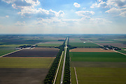 Nederland, Flevoland, Gemeente Zeewolde, 27-08-2013; Vogelweg in zuidwestelijke richting. Beplanting ontworpen door landschapsarchitect bij de inrichting van de polder,  dubbele rijen populieren.<br /> Vogelweg in the newe polder Flevoland. Planting designed by landscape architect for the design of the polder, double rows of poplars.<br /> aerial photo (additional fee required);<br /> copyright foto/photo Siebe Swart.