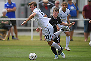 Auckland City FC's Andrew Blake trips over Hawke's Bay United's Jackson Woods in the Handa Premiership football match, Hawke's Bay United v Auckland City FC, Bluewater Stadium, Napier, Sunday, January 31, 2021. Copyright photo: Kerry Marshall / www.photosport.nz