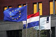 Nederland, the Netherlands, the Hague, Den Haag, 4-11-2016Vlaggen van de EU, europese Unie, de nederlandse driekleur en met het logo van het ministerie van binnenlandse zaken wapperen in de wind voor het ministerie .Foto: Flip Franssen