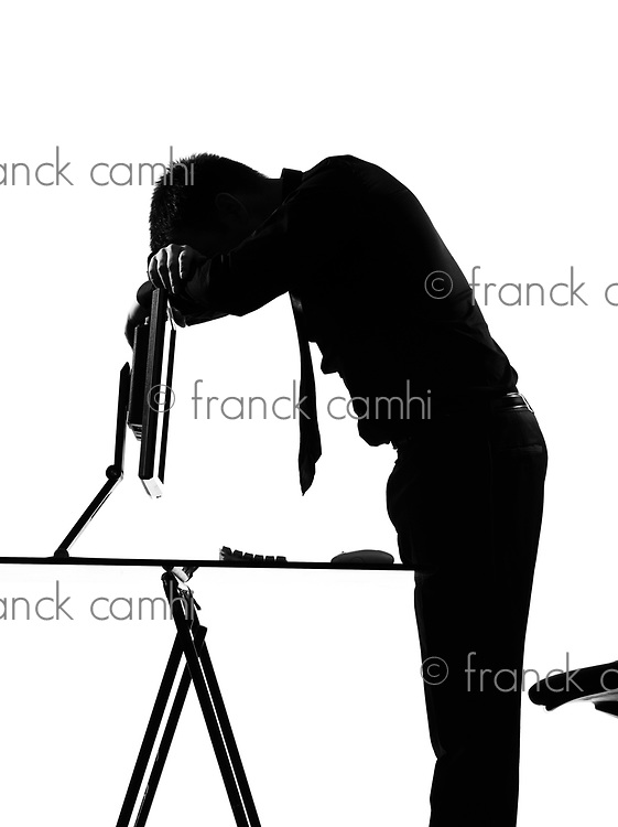 silhouette caucasian business man  computing expressing tired sad behavior full length on studio isolated white background