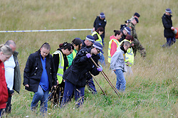 © Licensed to London News Pictures. 06/08/2012 . Police and volunteers searching a field near the town of  New Addingtonn near Croydon, South London for Missing 12 year old Tia Sharp, on August 6, 2012. 12 year old Tia Sharp has been missing from the Lindens on The Fieldway Estate in New Addington since Friday last week. Photo credit : Grant Falvey/LNP