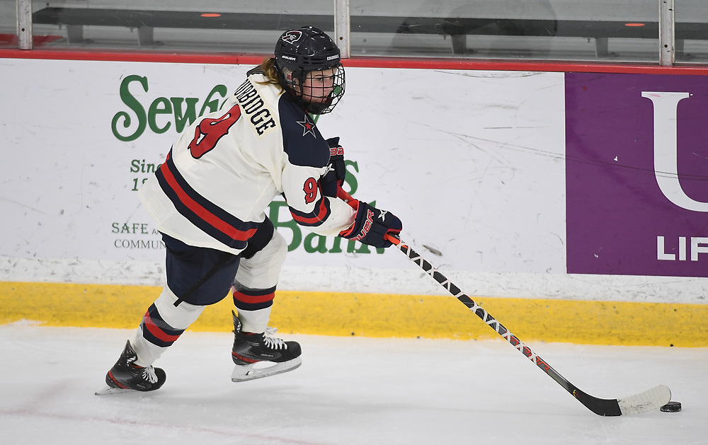 PITTSBURGH, PA - DECEMBER 03: Maggy Burbidge #9 of Robert Morris Colonials skates with the puck in the second period during the game against the Lindenwood Lions at Clearview Arena on December 3, 2020 in Pittsburgh, Pennsylvania. (Photo by Justin Berl/Robert Morris Athletics)