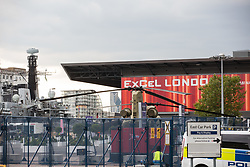 London, UK. 12th September, 2021. HMS Argyll, the longest-serving Type 23 Frigate in the Royal Navy, and a military helicopter are pictured outside ExCeL London in advance of the DSEI 2021 arms fair. Activists from a range of different groups continue to protest outside the venue for one of the world's largest arms fairs.