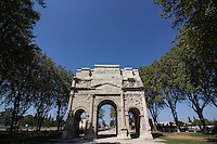 The Triumphal Arch of Orange is a monument characteristic of Roman architecture in Provence. This arch is built with of three openings and decorative figures sculpted into the limestone. This arch is one of the oldest and biggest of its kind from the Roman period. The Triumphal Arch of Orange is considered as one of the most important Roman Gaul relics.  The Triumphal Arch does not represent any particular victory.  Rather, it  symbolizes Roman supremacy over land and sea and is dedicated to the glory of its armies and Emperor Tiberius Caesar.  The Triumphal Arch of Orange is a UNESCO World Heritage site.