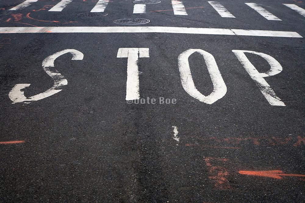 road stop signal on an asphalt with orange arrow repair adjustment indication markings