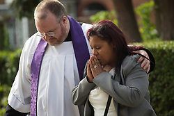 © licensed to London News Pictures. London, UK 27/09/2013. Andrea Moss (right), mother of Sabrina Moss arriving Sabrina Moss's funeral at St Alphage Church in Burnt Oak, north London on Friday, 27 September 2013. Nursery teacher Sabrina Moss was shot dead in Kilburn while out celebrating her 24th birthday on Saturday 24 August 2013. Photo credit: Tolga Akmen/LNP