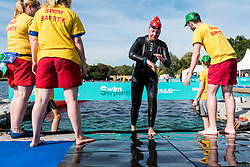 © Licensed to London News Pictures. 24/09/2016. London, UK. A participant completes their swim in the first ever Swim Serpentine, held in the famous lake in Hyde Park.  Raising thousands for charity and with water temperatures of 18C, swimmers navigate the one mile clockwise route around the lake.  The two-day open water swimming festival includes the British Open Water Swimming Championships on Sunday. Photo credit : Stephen Chung/LNP