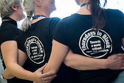 """26 April 2018, Bogotá, Colombia: The Global Christian Forum gathers in Bogotá on 24-27 April 2018 under the theme of """"Let mutual love continue"""". Here, GCF participants dressed in Thursdays in Black t-shirts, for a world without rape and violence."""