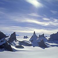ANTARCTICA, Queen Maud Land.  Fenris Mountains.  L to R: Holtanna (2650m), Holdsttind (2577m), Midgard (bkg), Kinntanna (2721m), Stetind, Ulvetanna (2931m).