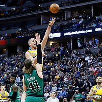 10 March 2017: Denver Nuggets center Mason Plumlee (24) goes for the jump shot over Boston Celtics center Kelly Olynyk (41) during the Denver Nuggets 119-99 victory over the Boston Celtics, at the Pepsi Center, Denver, Colorado, USA.